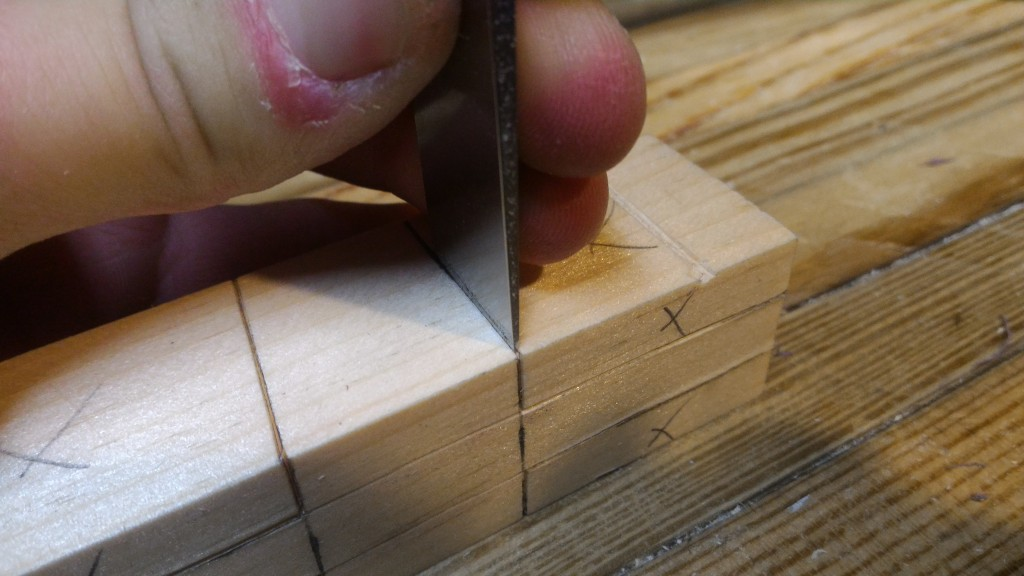 Using a chisel to mark a knife line
